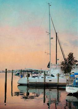 Sunrise at the marina -- looking at our sailboat, Windsong II