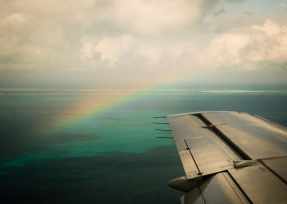 Flying over the Bahamas Banks you can clearly see the coral reefs. I thought seeing rainbow was a good omen.